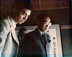 1973, Tun Rahman's a courtesy call to Kisshomaru Doshu at Hombu Dojo, looking at O'Sensei's calligraphy.