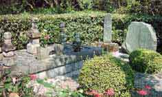 Graveyard of Rev. Eyi Tansetu Yamada and wife Kou beside the house with ancestral tombs.